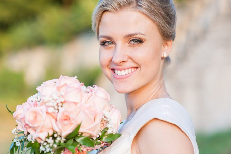 Bride Smiling Holding Flowers
