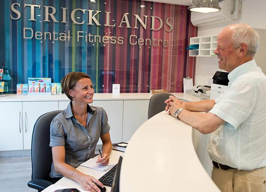 Stricklands Receptionist Interacting with Patient