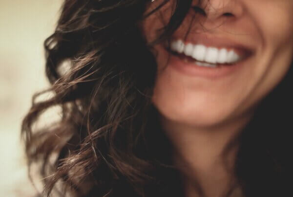 Women Smiling With Black Hair